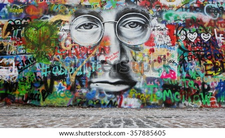 PRAGUE, CZECH REPUBLIC - JANUARY 04: The Lennon Wall since the 1980s is filled with John Lennon-inspired graffiti and pieces of lyrics from Beatles songs on January 04, 2016 in Prague, Czech Republic - stock photo
