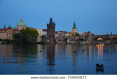 PRAGUE, CZECH REPUBLIC - JULY 23, 2017: Charles Bridge from Naplavka u Hergetovy Cihelny at sunset.