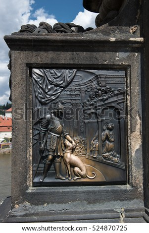 PRAGUE, CZECH REPUBLIC - JULY 31, 2016: close view of monument on the Charles Bridge aka Karluv Most