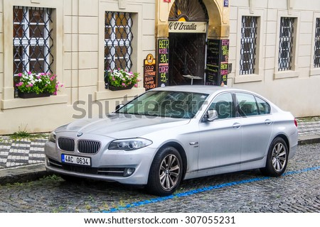 PRAGUE, CZECH REPUBLIC - JULY 21, 2014: Motor car BMW F10 5-series at the city street. - stock photo