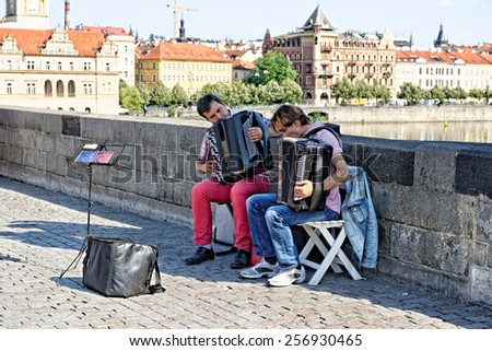 PRAGUE, CZECH REPUBLIC - JULY 3, 2014: Performance of street musicians on the Charles Bridge. Busking is legal form of earning money on Prague Streets. - stock photo