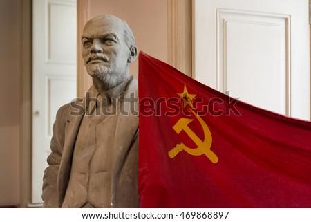 PRAGUE, CZECH REPUBLIC, JULY 6,2016: Statue of Vladimir Lenin and USSR flag inside Museum of Communism, Prague, Czech Republic.