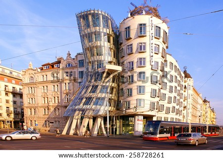 PRAGUE,CZECH REPUBLIC-JULY 18,2014.Street view at the sunset ,with famous Dancing House,its nickname is Fred and Ginger House after the famous dancers.Street traffic in Prague,famous European capital. - stock photo