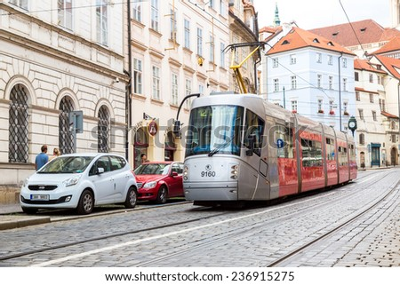 PRAGUE CZECH REPUBLIC -  JULY 21: Tram at old street in Prague, Czech Republic on July 21, 2014. Prague historical Center, including most of the city major sites, became a UNESCO-listed site in 1992.