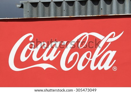 PRAGUE, CZECH REPUBLIC - JULY 11, 2015: Wall painted with Coca-Cola logo. The Coca-Cola Company is an American multinational beverage corporation. - stock photo