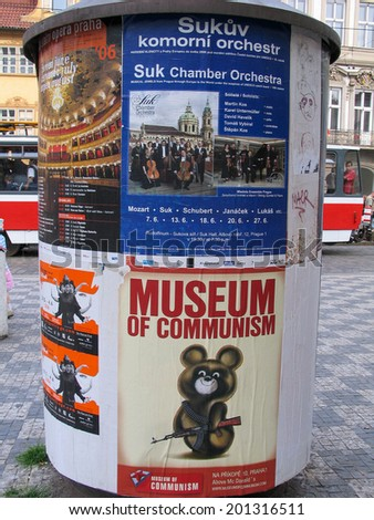 PRAGUE, CZECH REPUBLIC - JUNE 15, 2006: Advertising pillar with Museum of Communism banner in Old Town on June 15, 2006, Prague, Czech Republic. Annually Prague is visited by 3,5 million tourists  - stock photo