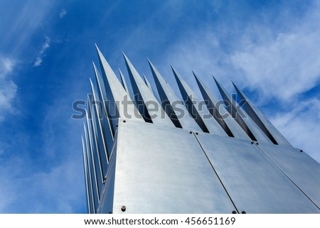 PRAGUE, CZECH REPUBLIC - JUNE 04, 2016: Art installation at the park near the river Vltava in Prague. Art objects in the form of sharp teeth in the middle of the park. Silver metal.