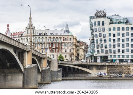 PRAGUE, CZECH REPUBLIC - JUNE 20, 2014: Dancing House (built in 1996) or Fred and Ginger House in the center of Prague. Building was designed by Vlado Milunic and Frank Gehry. - stock photo