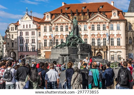 PRAGUE, CZECH REPUBLIC - JUNE 20, 2014: Many tourists visit the Old Town Square in Prague. Prague is Europe's 5th most visited city and World Heritage Site by UNESCO. - stock photo
