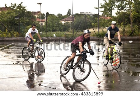 Prague, Czech Republic - June 19, 2016: Members of the Prague bike polo club practise on a rainy summer day to prepare for an international bike polo tournament.