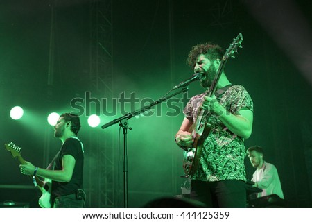 PRAGUE, CZECH REPUBLIC - JUNE 26, 2016: Singer Yannis Philippakis of The Foals performs live on stage during a concert at Metronome Festival on June 26, 2016 in Prague, Czech Republic.