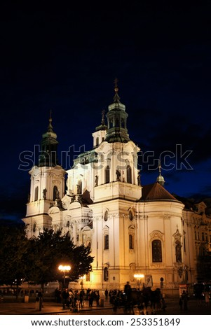PRAGUE, CZECH REPUBLIC - JUNE, 21st, 2014: Temple of Saint Mikulas (St. Nicholas) famous landmark in Prague during night with lot of tourists in front of it on 21st June 2014. - stock photo