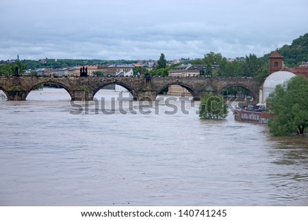 PRAGUE, CZECH REPUBLIC - JUNE 2: Swollen Vltava river with Charles Bridge, on June 2, 2013 in Prague, Czech Republic