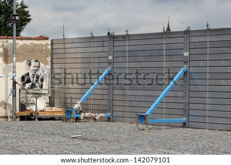 PRAGUE, CZECH REPUBLIC - JUNE 4: The Prague Flood, flood barriers and wall with the graffiti portrait of Vaclav Havel in Mala strana, on June 4, 2013 in Prague, Czech Republic - stock photo