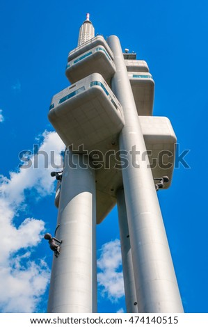 PRAGUE, CZECH REPUBLIC - JUNE 21, 2016:  Zizkov telecommunication tower with unique sculptures of babies by Czech artist David Cerny