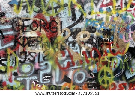 PRAGUE, CZECH REPUBLIC - MARCH 03. 2015: The Lennon Wall since the 1980s is filled with John Lennon-inspired graffiti and pieces of lyrics from Beatles songs on March 03, 2015 in Prague. - stock photo