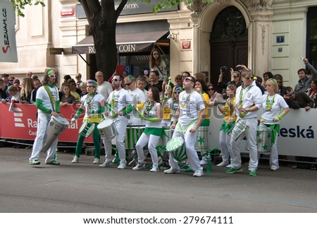 PRAGUE, CZECH REPUBLIC - MAY 3, 2015: Band playing an african type of music welcoming the succesful participants of Prague Marathon, 100 m before finish at famous Parizska street - stock photo