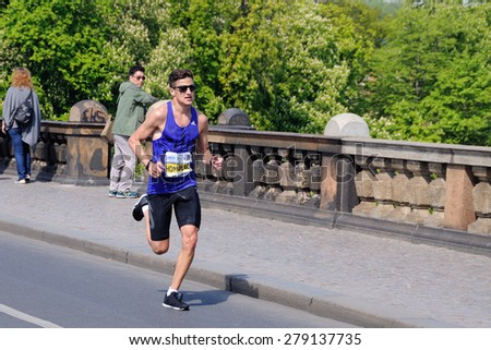PRAGUE, CZECH REPUBLIC - MAY 3, 2015: Czech runner Jiri Homolac runs the Volkswagen Marathon Prague, May 3, 2015 in Prague, Czech republic. - stock photo