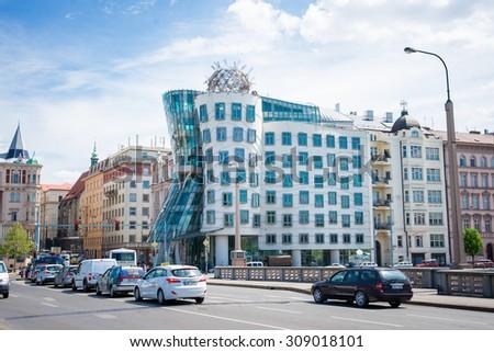 "PRAGUE, CZECH REPUBLIC - MAY 8, 2015: ""Dancing House"" Deconstructivist original administrative office building near the northern limits of the city center. May 8, 2015. Prague, Czech Republic. - stock photo"