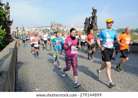 PRAGUE, CZECH REPUBLIC - MAY 3, 2015: Group of runners runs the Volkswagen Marathon Prague, May 3, 2015 in Prague, Czech republic. - stock photo
