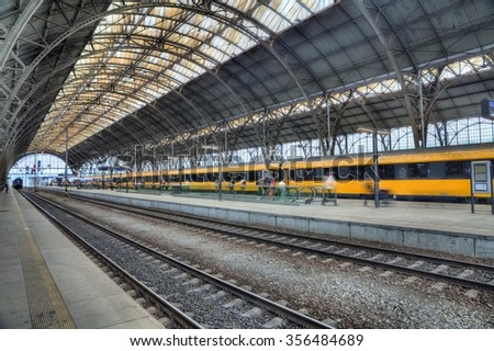 PRAGUE, CZECH REPUBLIC-MAY30: Main railway station in the Prague. Yellow train in background.