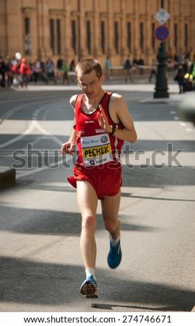 PRAGUE, CZECH REPUBLIC - MAY 3, 2015: Petr Pechek, future bronze medalist (out of Czech participants only) of the  Prague Marathon running on circa 33 km of the race - stock photo