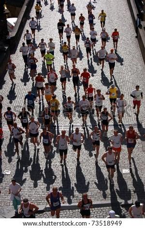 PRAGUE, CZECH REPUBLIC - MAY 13: Runners participate in the Prague International Marathon (PIM), May 13, 2007 in Prague, Czech republic. - stock photo