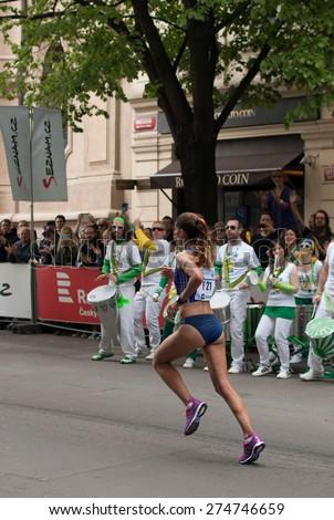 PRAGUE, CZECH REPUBLIC - MAY 3, 2015: Sara Moreira, the female silver medalist of  the Volkswagen Prague Marathon 2015 running her last 100 m through Parizska Street to the Old Town Square finish - stock photo