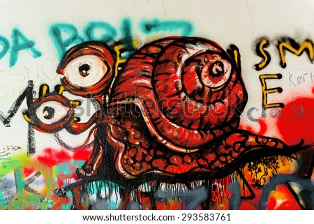 PRAGUE, CZECH REPUBLIC - MAY 21, 2015: Snail Illustration as Detail from Famous John Lennon Wall on Kampa Island in Prague filled with Beatles inspired graffiti and lyrics since the 1980s.