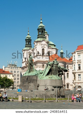 PRAGUE, CZECH REPUBLIC - MAY 20, 2014: Statue of Jan Hus and St.Nicholas church