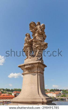 PRAGUE, CZECH REPUBLIC - MAY 10, 2015: Statue of St. Anne, mother of the Virgin Mary (circa 1707) on the balustrade of famous Charles Bridge in Prague (UNESCO site). Sculptor Matej Vaclav Jackel - stock photo