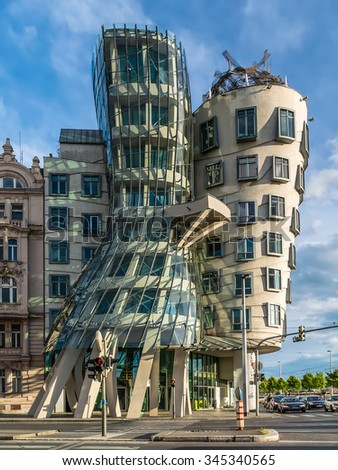"PRAGUE, CZECH REPUBLIC - MAY 11, 2014: The Dancing House, Prague, Czech Republic, Europe. Others have nicknamed it ""Drunk House"".  - stock photo"
