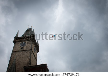 PRAGUE, CZECH REPUBLIC - MAY 3, 2015: The Old Town Square town hall and flying baloons against the sky - finish place of the Prague Marathon - stock photo