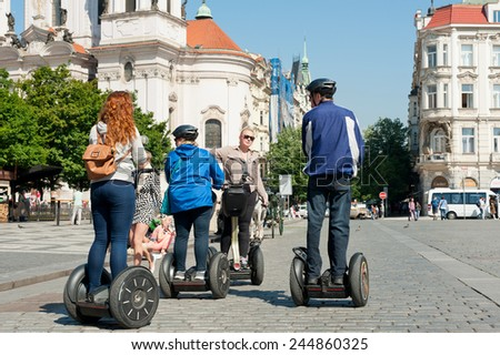 PRAGUE, CZECH REPUBLIC - MAY 20, 2014: Tourists visiting the city during their guided Segway tour  - stock photo