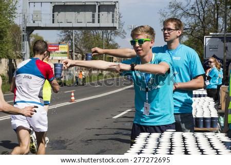 PRAGUE, CZECH REPUBLIC - 3 MAY 2015: Voluntary team of students at the refreshment point on Volkswagen Marathon Prague, Czech Republic.  - stock photo