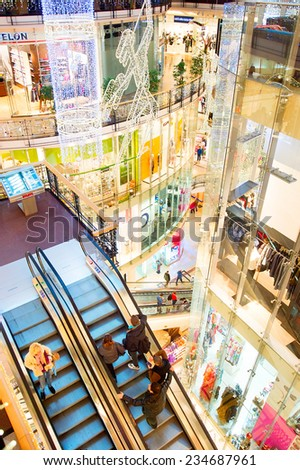 PRAGUE, CZECH REPUBLIC - NOV 18, 2014: Palladium shopping mall with Christmas decorations. Palladium is a shopping mall located in the cener of Prague. The mall contains 170 shops and 30 restaurants - stock photo