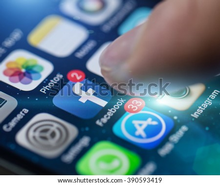 PRAGUE, CZECH REPUBLIC - NOVEMBER 17, 2015: A close-up photo of Apple iPhone 5s start screen with apps icons. - stock photo