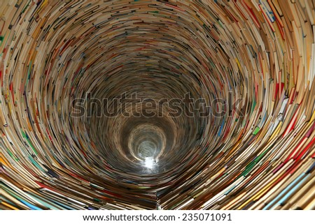 PRAGUE, CZECH REPUBLIC-  NOVEMBER 13, 2014: book tunnel in Prague library -- mirrors are used to create this effect - stock photo