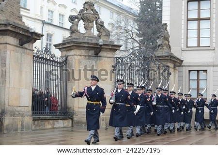 PRAGUE, CZECH REPUBLIC - NOVEMBER 28, 2012: Changing of the guard of honor guards at the Presidential Palace in Prague Castle. It takes place daily at noon, accompanied by a brass band.