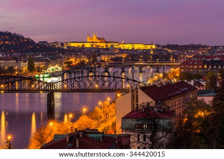 Prague, Czech Republic - November 8, 2015: Night view of the Prague castle and railway bridge over Vltava / Moldau river taken from the top of Vysehrad castle.