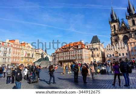 PRAGUE, CZECH REPUBLIC - NOVEMBER 13, 2015: Old Town Square with various architectural styles including the Gothic Church of Our Lady before Týn, the main church of the city since the 14th century - stock photo