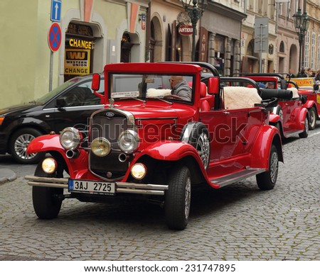 Prague, Czech Republic - November 9, 2014: Red Ford retro car waiting for the next customer to entertain. These cars are usually rented by the tourists visiting Prague. - stock photo