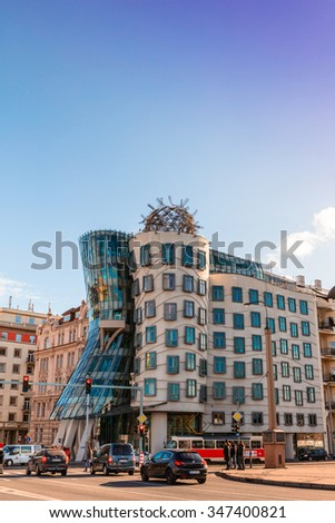 PRAGUE, CZECH REPUBLIC - NOVEMBER 14, 2015: Street view with very non traditional designed Dancing House on the Rasin Embankment nicknamed as Fred and Ginger House after the famous dancers. - stock photo