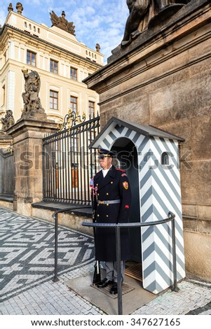 PRAGUE, CZECH REPUBLIC - NOVEMBER 14, 2015 : The Castle Guard at the entrance to the Castle area in Prague. Unidentified man. - stock photo