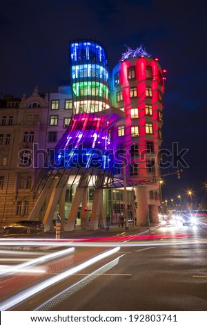 PRAGUE, CZECH REPUBLIC - OCT 23: A modern landmark in Prague, Dancing House or Fred and Ginger, at night on October 23 2013 in Prague, Czech Republic. The architects are Vlado Milunic and Frank Gehry. - stock photo