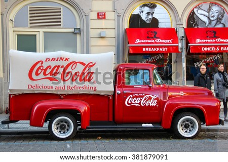 PRAGUE, CZECH REPUBLIC - Oct 23 2015: An old renovated red Ford vintage Coca cola truck (pickup) in a parking lot., Czech Republic, on Oct 23, 2015. - stock photo