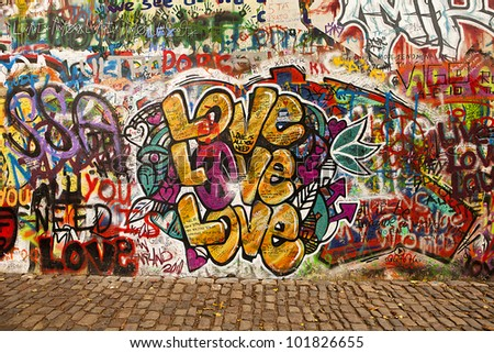PRAGUE, CZECH REPUBLIC - OCTOBER 7: A section of the Lennon Wall in Prague on October 7, 2010. This landmark wall is open to public graffiti in remembrance of the Velvet Revolution in 1988. - stock photo