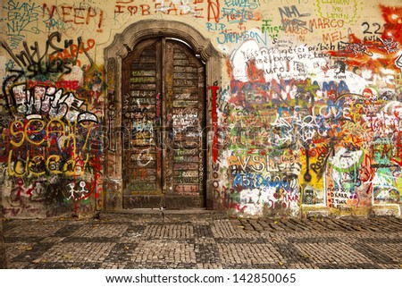 PRAGUE, CZECH REPUBLIC - OCTOBER 7, 2010: Colorful graffiti on the Lennon Wall in Prague on October 7, 2010. The wall, focused on peace, is a landmark of the Velvet Revolution in the 1980s. - stock photo