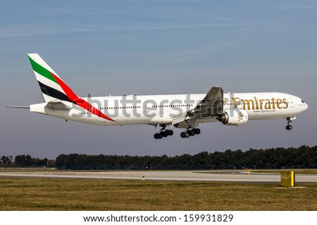 PRAGUE, CZECH REPUBLIC - OCTOBER 10: Emirates Boeing 777-31H lands at PRG Airport on October 10,2013. Emirates is an airline based in Dubai. - stock photo