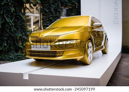 PRAGUE, CZECH REPUBLIC  OCTOBER 7, 2014: New car Skoda Fabia in golden color displayed in the exterior during design event Designblok 2014 in Prague - stock photo